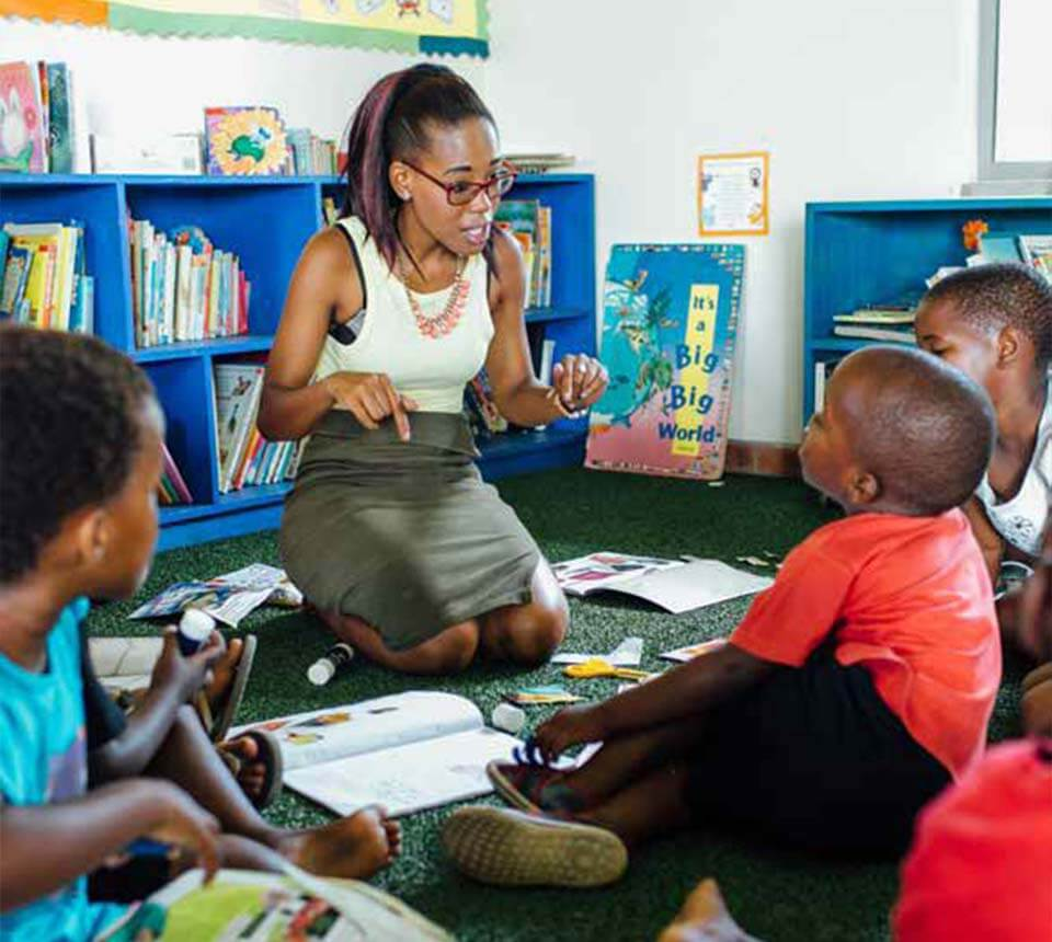 African female Teacher with African children learner