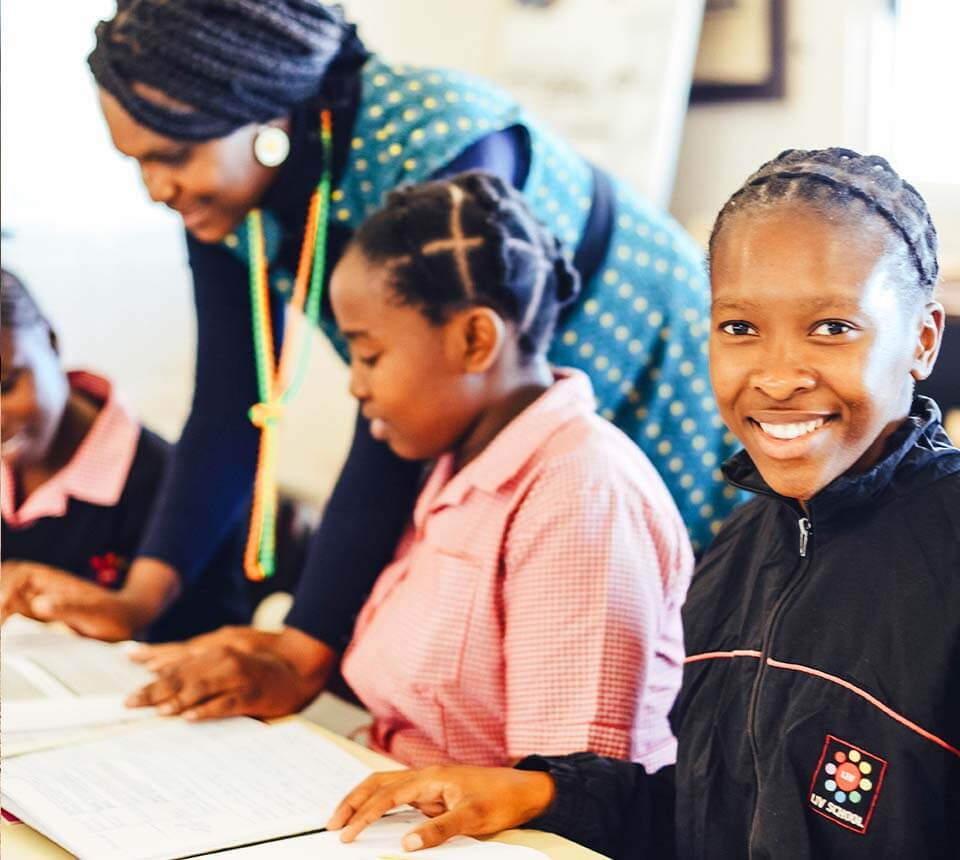 Teacher With Smiling African Girl Learner